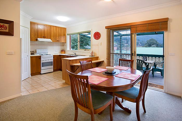 Fully fitted kitchen and dining room with mountain views